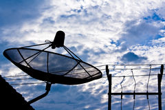 Satellite dish and electricity post Royalty Free Stock Images
