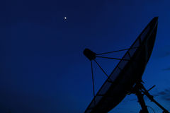Satellite dish in evening sky royalty free stock photography