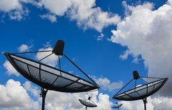 Satellite dish on evening sky. A satellite dish on evening sky Royalty Free Stock Image