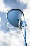 Satellite dish facing a cloudy sky Stock Images