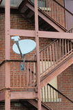 Satellite Dish on Fire Escape Stock Photo