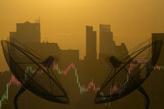 Satellite dish and forex graph double exposure with city light. S Royalty Free Stock Photo