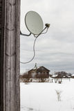 Satellite dish hanging on a wooden house in the village Royalty Free Stock Photos