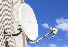 Satellite dish on a house Stock Photos