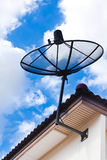 Satellite dish on house roof. Royalty Free Stock Photography