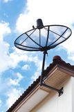 Satellite dish on house roof. Stock Photo