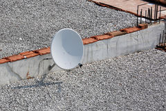 Satellite Dish on a House Roof Royalty Free Stock Photos