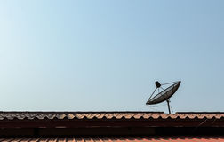 A satellite dish. A satellite dish install on the roof for the pleasure of watching TV Stock Images