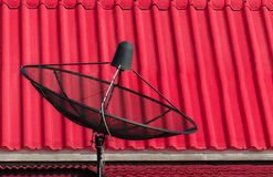 The satellite dish isolated behind pink texture. Stock Photography