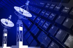 Satellite dish and key board Royalty Free Stock Images