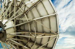 Satellite dish. A large satellite dish pointing towards space as if sending or receiving signal from a in orbit satellite royalty free stock photography
