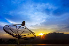 Satellite dish and morning light sky for telecom and broadcastin Royalty Free Stock Photo