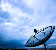Satellite dish and nimbus Royalty Free Stock Image