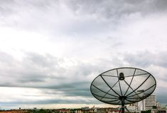 Satellite dish and nimbus Royalty Free Stock Photo