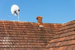 Satellite dish on the old roof Stock Photo