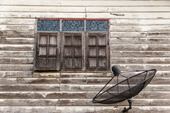 Satellite dish. At old wall home near windows Stock Photos