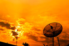 Satellite dish with orange sky Stock Image