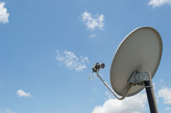 Satellite dish outdoor on blue sky background Royalty Free Stock Photo