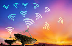 Satellite dish receiving data signal for communication Stock Photo