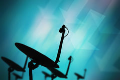 Satellite dish recieve data. With blue background Stock Image