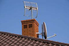 Satellite dish on the roof Stock Images