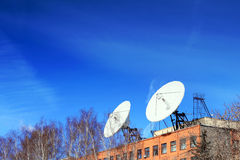 Satellite Dish on roof. Royalty Free Stock Photography