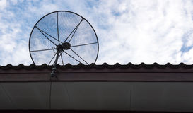 Satellite dish on the roof with a beautiful blue sky. stock image