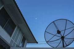 Satellite dish on the roof Stock Photo