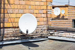 Satellite dish on the roof of the building Stock Photography