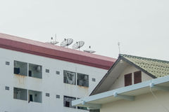 Satellite dish on the roof Royalty Free Stock Photography