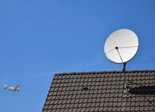 Satellite dish on the roof of a building Stock Photos