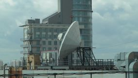 Satellite dish on the roof on the building background stock video footage