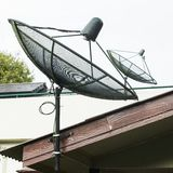 Satellite dish on roof Royalty Free Stock Photo