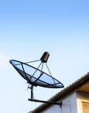 Satellite dish on roof Royalty Free Stock Photo