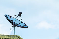 Satellite dish on the roof  of the house Stock Photos