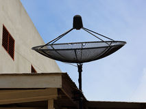 Satellite dish on roof house in the day Stock Images