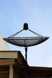 Satellite dish on roof house in the day Royalty Free Stock Images
