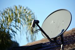 Satellite dish on the roof of a house Royalty Free Stock Photo