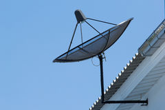 Satellite dish on roof. Satellite dish on house's roof Royalty Free Stock Image