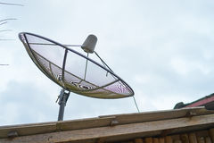 Satellite dish on roof Royalty Free Stock Photography