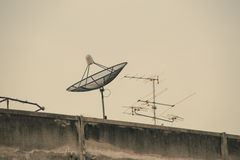 Satellite dish on roof of old building. Stock Images