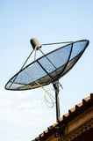 Satellite dish. On roof and sky Stock Photos