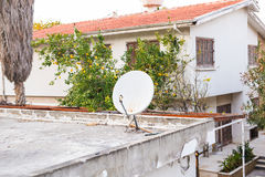 Satellite dish on the roof. Royalty Free Stock Images