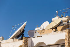 Satellite dish on the roof. Royalty Free Stock Photo