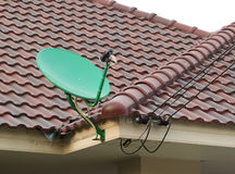 Satellite dish on the roof of tile Stock Photos