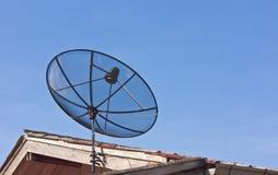 Satellite dish on roof top Stock Photos