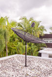 Satellite dish on roof top. With white pebble Royalty Free Stock Photo