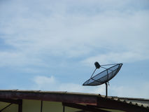 A satellite dish on the roof Royalty Free Stock Photos