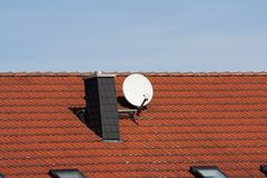 Satellite dish on a roof Stock Photo