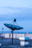 Satellite Dish on the Rooftop Stock Photography